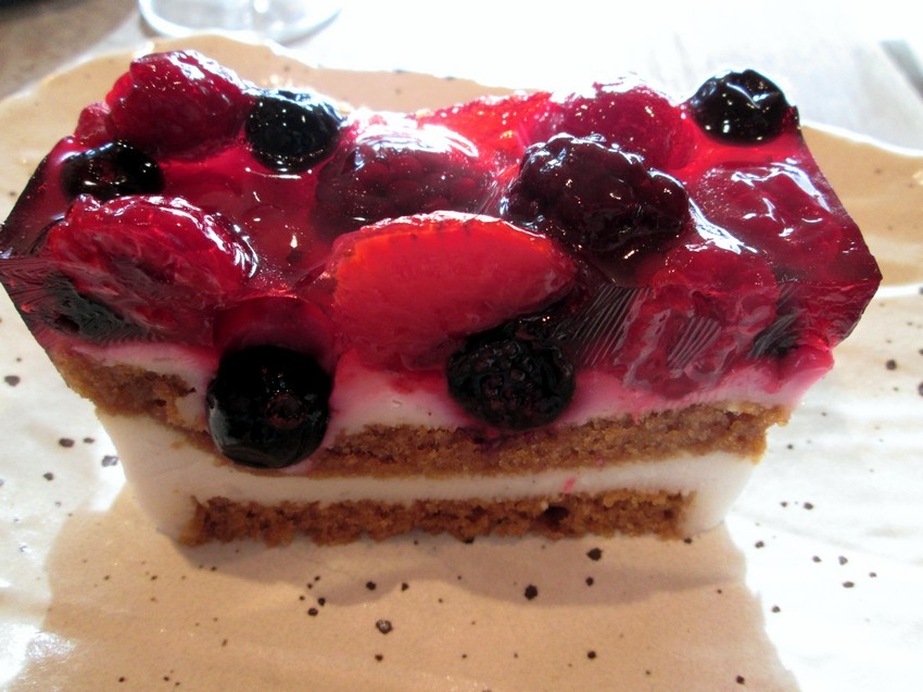 coconut cream layer cake topped with berries
