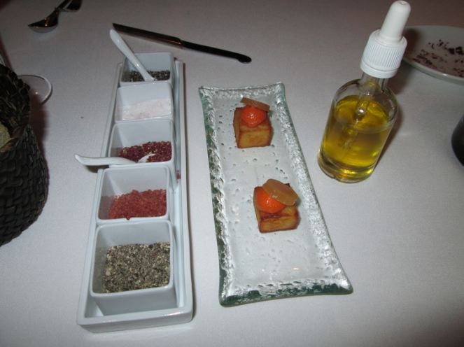 spices, potato cube with pepper cream and tomato gel, and olive oil