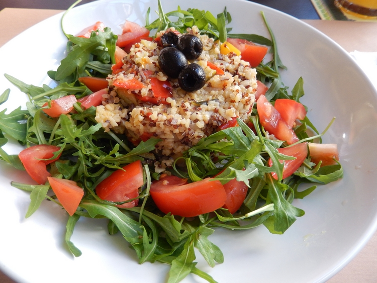 Quinoa with vegetables, rucola, tomatoes, and olives, 13,50€