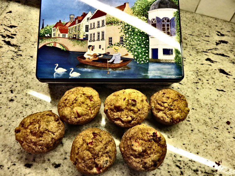 Cranberry orange muffins, and Bruges souvenier cookie tin