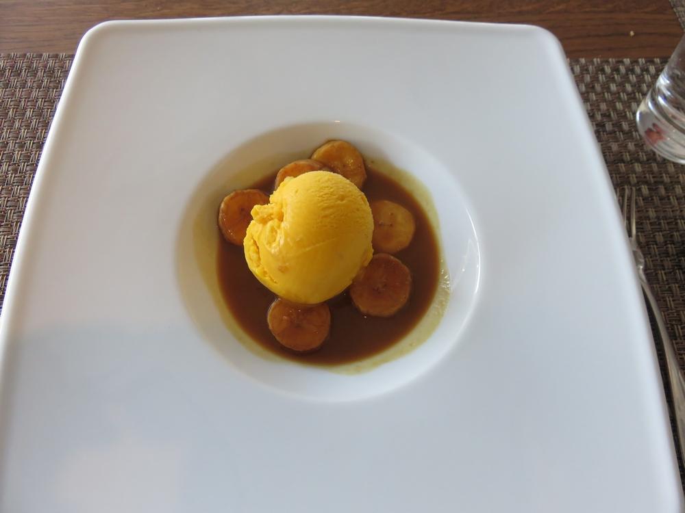 mango sorbet with bananas and caramel sauce