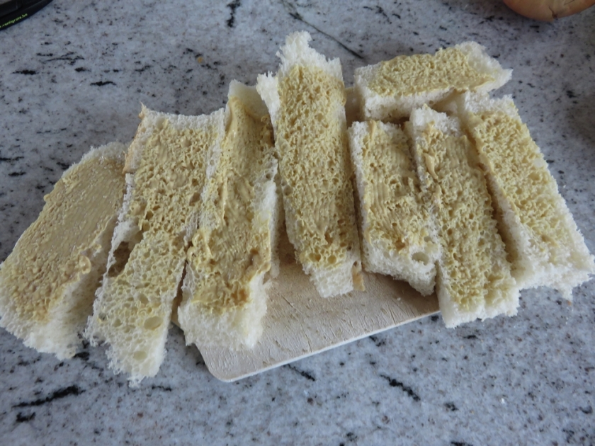 Bread smeared with mustard