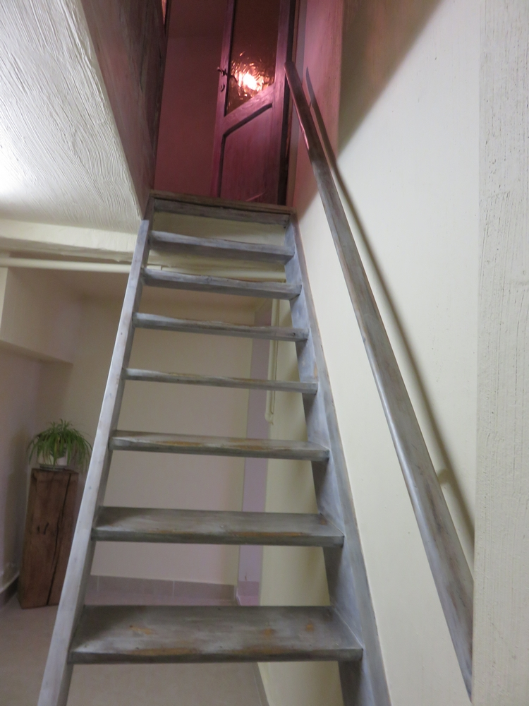 steep stairs going down to the toilets