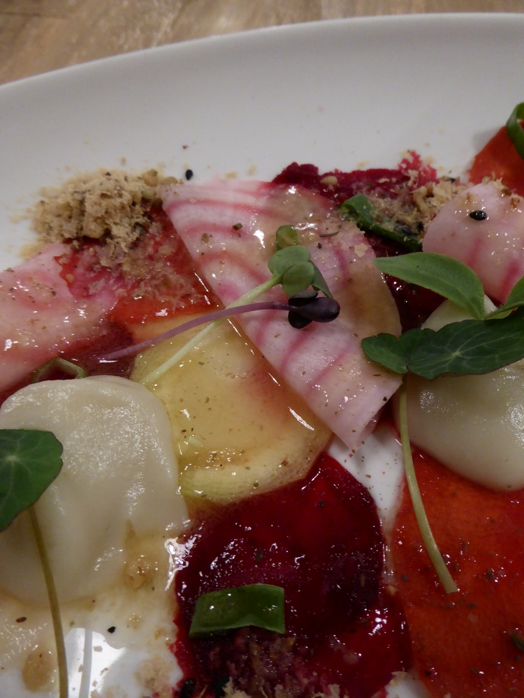 carpaccio of root vegetables, Jerusalem artichoke, vegan parmesan with argan oil,