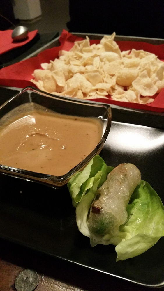spring rolls with lettuce leaves and peanut dipping sauce