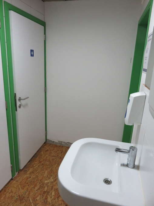 Toilets in the back, clean and spacious. Bar Italiano