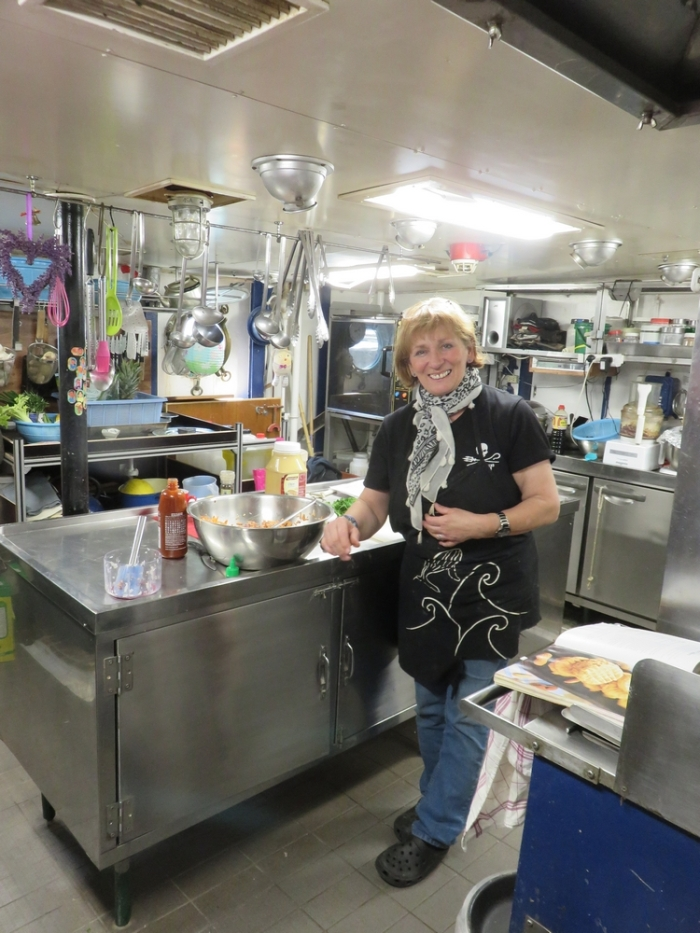 Cook Erica in the galley