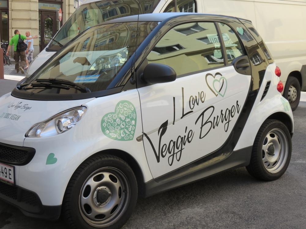 Car, parked next to the terrace, I love veggie Burger, Vienna, Austria