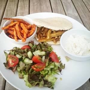 Sweet potato fries, pita with vegan shoarma, homemade garlic veganaise, and tomato and salad from the garden 🍎🌿🍎🌿🍎🌿🍎
