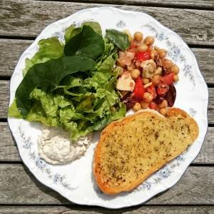 Summer on a plate! Mixed green salad straight from the garden, salad with olives, artichokes, sundried tomatoes, chickpeas, and roasted pinenuts, garlic bread and tofu tzaziki. #wheredoyougetyourprotein
