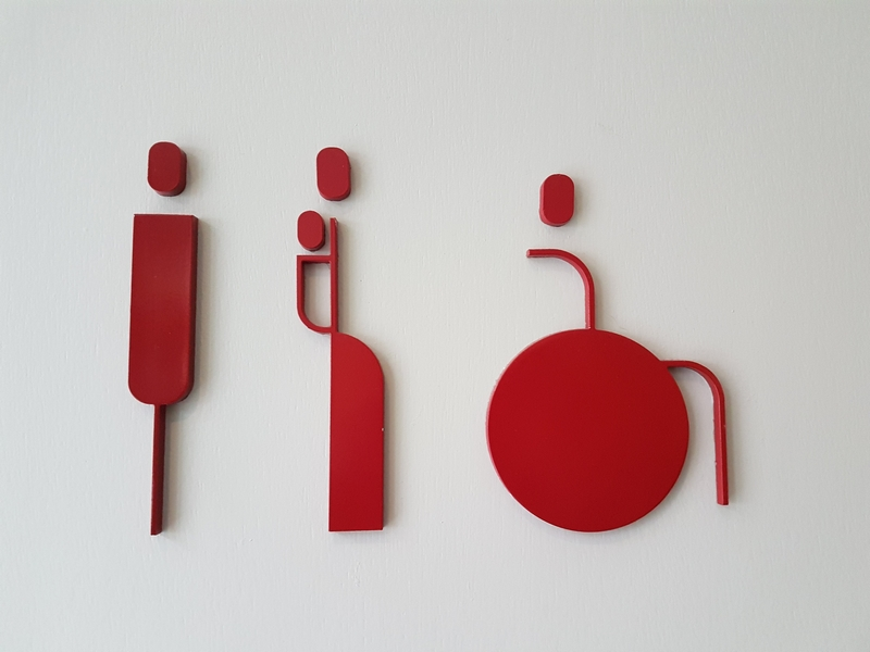 three elegant red signs/figures on a white background. male - female - wheelchair